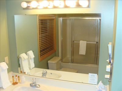 Lewiston cottage rental - Upstairs Full Bathroom with Shower and Wall Mounted Hairdryer