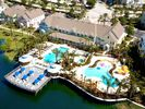 Aerial view of lagoon, seasonally heated pools and clubhouse - Runaway Beach Resort condo vacation rental photo