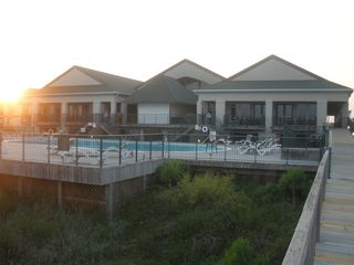 Ocean Isle Beach condo photo - Ocean front pool with Tiki Bar and Grill