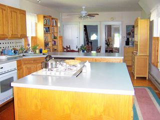 Deer Isle house photo - Kitchen with dishwasher has dining area at far end.