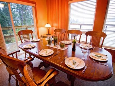 Dining room with large oak table that seats 8. Great for entertaining!