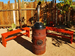 Joshua Tree house photo - Our outdoor fire barrel created by local artist