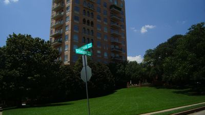 corner of Gillespie and Turtle Creek Mansion front lawn and Mansion tower