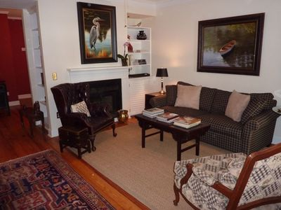 Comfortable Living room with original art, fireplace, and TV