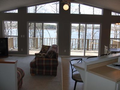 The open floor plan provides panoramic views of the lake!