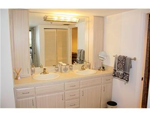 Highland Beach condo photo - Bath 2 - Double vanities + ensuite bath with soaking tub.