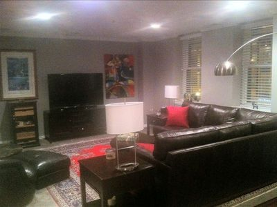 Beautiful living room with 65' LCD TV with stereo, Direct TV and Apple TV
