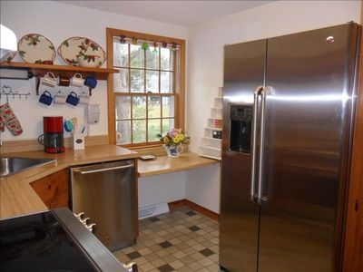 Brand new stainless steel appliances add polish and convenience to the kitchen.