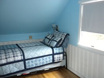 the other upstairs bedroom with two twin beds