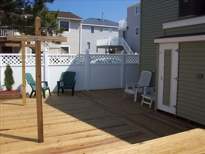 PRIVACY FENCE IN REAR YARD WITH GROUND LEVEL DECK AND OUTSIDE SHOWER...