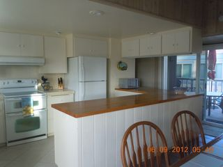 Del Mar condo photo - kitchen looking out to deck