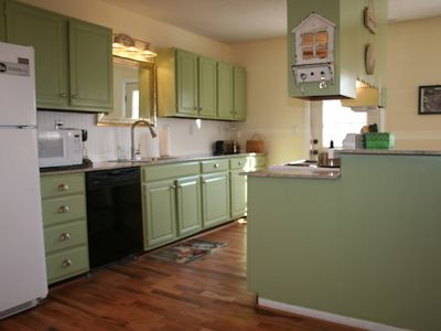 Fully-stocked kitchen with granite counter tops