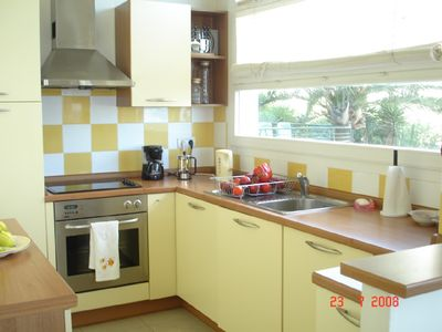 Fully equipped kitchen with garden & sea view