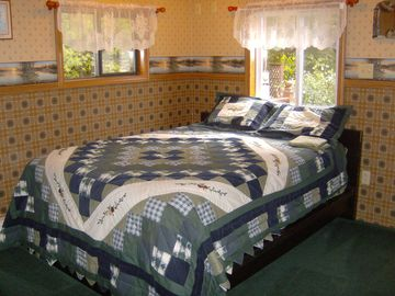 2nd Bedroom with Queen Size Bed and view of back deck area.
