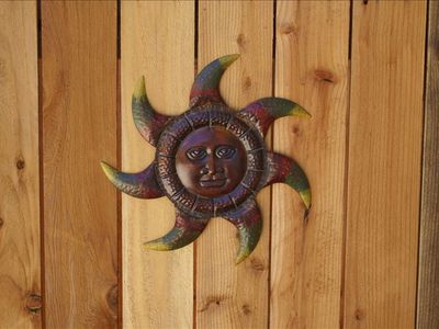 Solstice sun on front gate