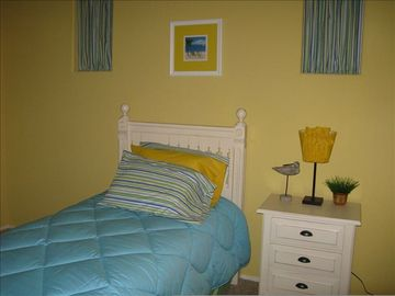 """The Shores"" Bedroom with Twin bed"