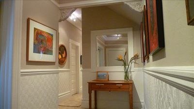 Elegant Entry Hall with Period Detail and Original Artwork. Wall to Wall Carpet.