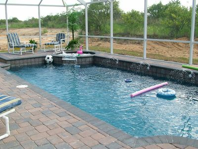 Secure screened in pool with safety fence. The kids absolutely LOVE our pool!!