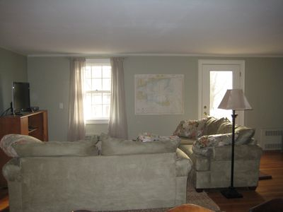 Soft muted decor, new couches, hardwood floors Flat Screen TV-door leads to deck