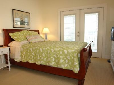 Bedroom with french doors to screened porch.