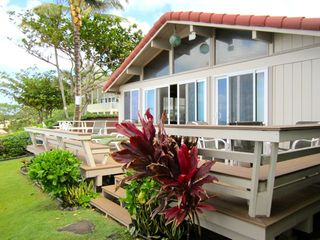 Sunset Beach house photo - Lawn between deck and beach..