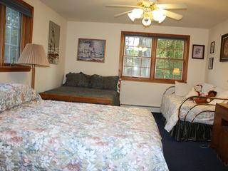 Burt Lake house photo - This room has a queen and a double and to singles with the pull out.