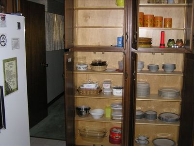 Kitchen: fully equipped with pots, pans, utensils, dishes, and silverware
