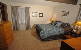 Hillman house photo - The master bedroom offers privacy and comfort