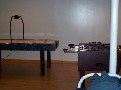 Air Hockey & Table Soccer Tables in basement  gameroom