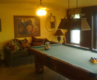 Enjoy a little billiards game before dinner