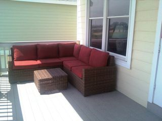 Galveston house photo - Lower level patio. Relax and enjoy the breeze and the views.