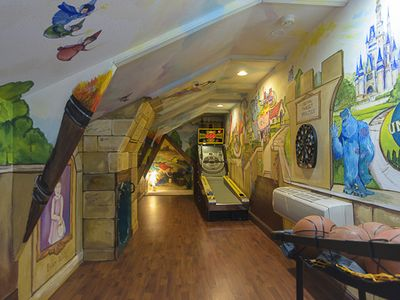 loft w/ slide into ballpit, skeeball, darts, hoops, and more