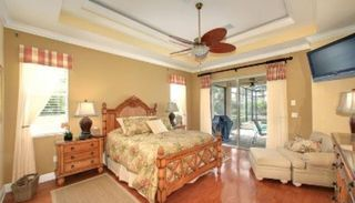 "Marco Island house photo - Master bedroom with Tommy Bahama furniture, lounge chair, 42"" flat screen tv."