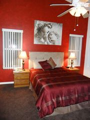 Master bedroom, flat screen TV, DVD player. - Phoenix house vacation rental photo