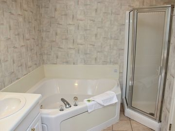 Master Bathroom with Whirlpool Tub and Stall Shower
