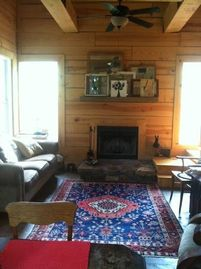Auburn cabin rental - Open living/kitchen area. Ceiling fans, wood burning fireplace.
