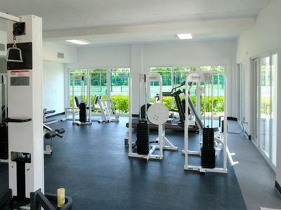 Large well Equipped Fitness Center with view of Pool, Spa and Tennis Courts.
