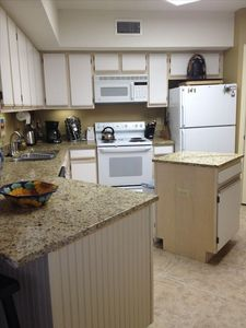 Updated Kitchen with Granite  countertops and new tile floor.