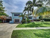 Beautiful pool home - walking distance to city parks, Mizner park, and beaches