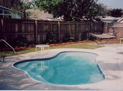 Rehoboth Beach villa rental - Heated pool surrounded by privacy fence and rose garden.