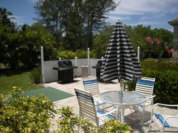 Gas grills, shuffleboard, outdoor shower and picnic area near pool