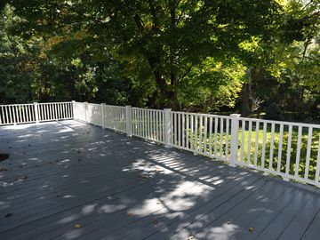 Large private deck with view of garden and woods