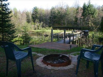 Home includes a fire pit on the river side.