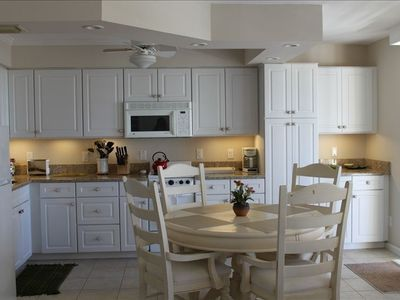 Full Kitchen with granite countertops and under cabinet lighting