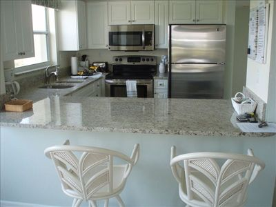 Brand new granite counter tops, new stainless steel appliances, and new cabinets