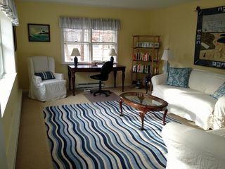 Chatham house photo - Sunny living room looks out bay window and has large desk & high-speed internet