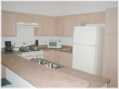Crescent Lakes house rental - View of the kitchen - there is also a utility room with washer and dryer