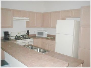 View of the kitchen - there is also a utility room with washer and dryer