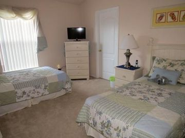 Upstairs Twin bedroom with LED TV and access to shared full washroom.