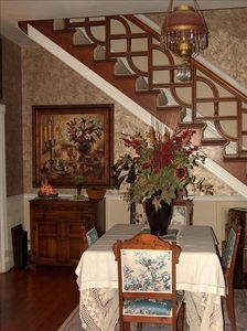 View of original staircase and dining in Victorian style